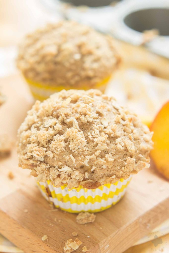Start your morning with these delicious Peach Oatmeal Crumb Muffins. They're super moist and tender, studded with sweet, juicy peaches and are overflowing with an irresistible oatmeal crumb topping. These just might be your next favorite muffin recipe and for good reason! | Strawberry Blondie Kitchen