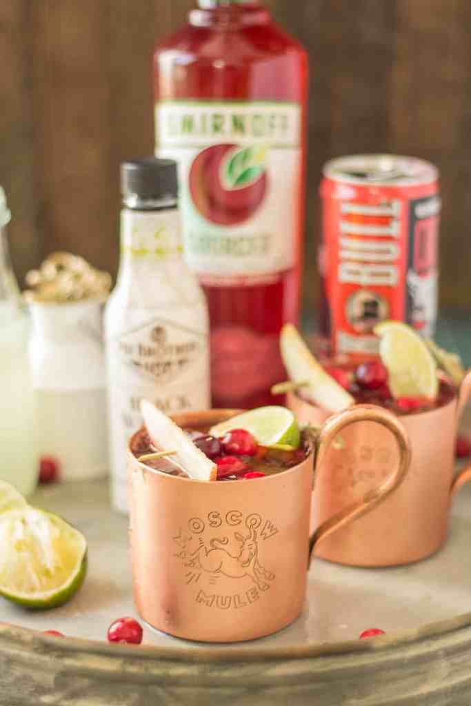 Serve this Cranberry Apple Moscow Mule at your parties this season and you'll always have a full house. Cranberry Apple vodka is crafted with black walnut bitters, ginger beer and lime giving a delicious nutty Fall twist to a classic! | Strawberry Blondie Kitchen