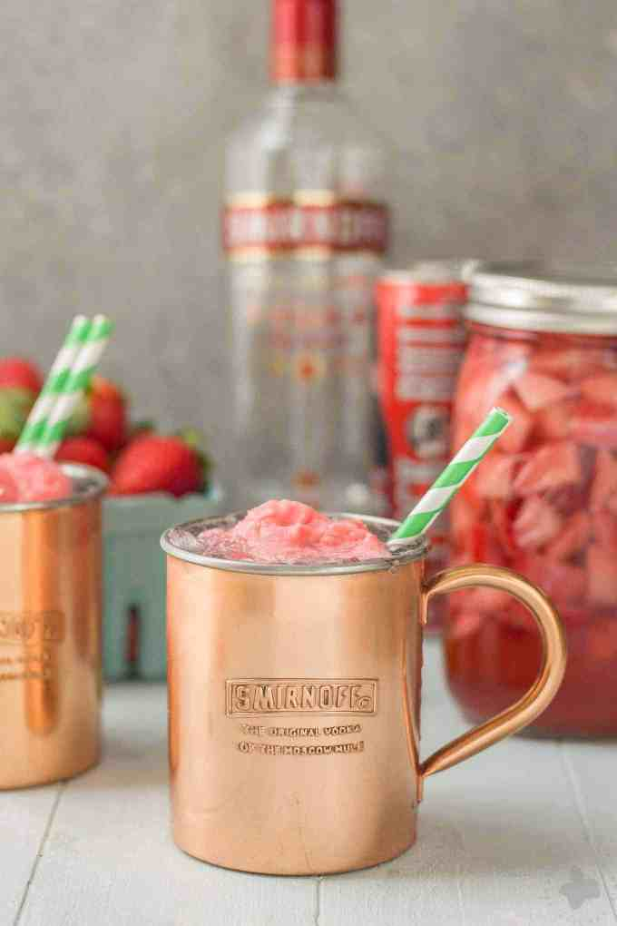 No need to wait for summer to enjoy this delicious and refreshing Strawberry Moscow Mule Float. Made using homemade strawberry vodka and strawberry sorbet, you're sure to love this twist on a classic! | Strawberry Blondie Kitchen