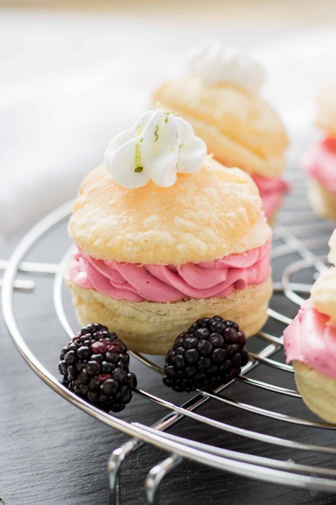 These elegant but simple, Blackberry Lime Buttercream Puffs are sweet, creamy and light. They're filled with a delicious homemade lime curd and fresh blackberry compote. | Strawberry Blondie Kitchen
