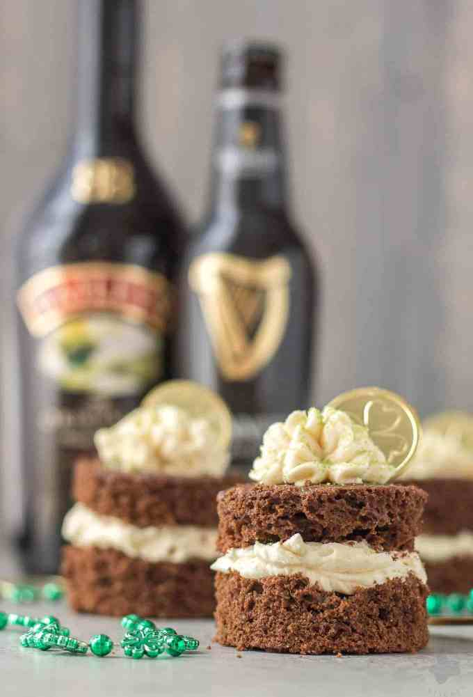 Guinness and Baileys are a match made in Heaven in this Chocolate Guinness Mini Cakes with Baileys Buttercream. It's decadently moist, rich and the perfect ending to your St. Patrick's day festivities. | Strawberry Blondie Kitchen