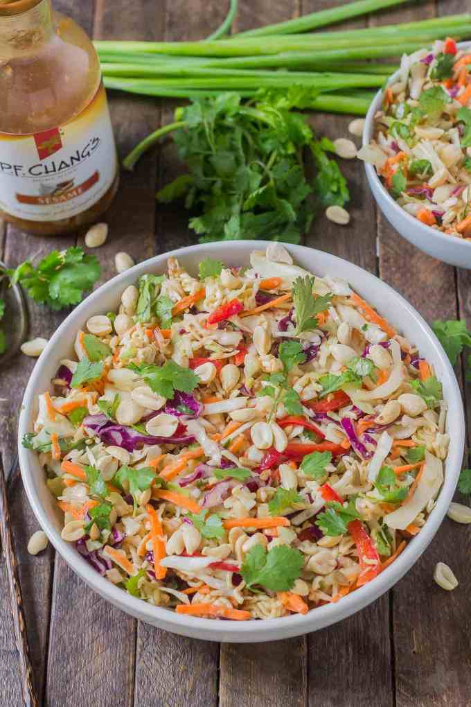 Simple and delicious, this Asian Sesame Noodle Slaw comes together quickly with a little help from P.F. Chang's Sesame sauce for you to be side dish ready in 5 minutes! | Strawberry Blondie Kitchen
