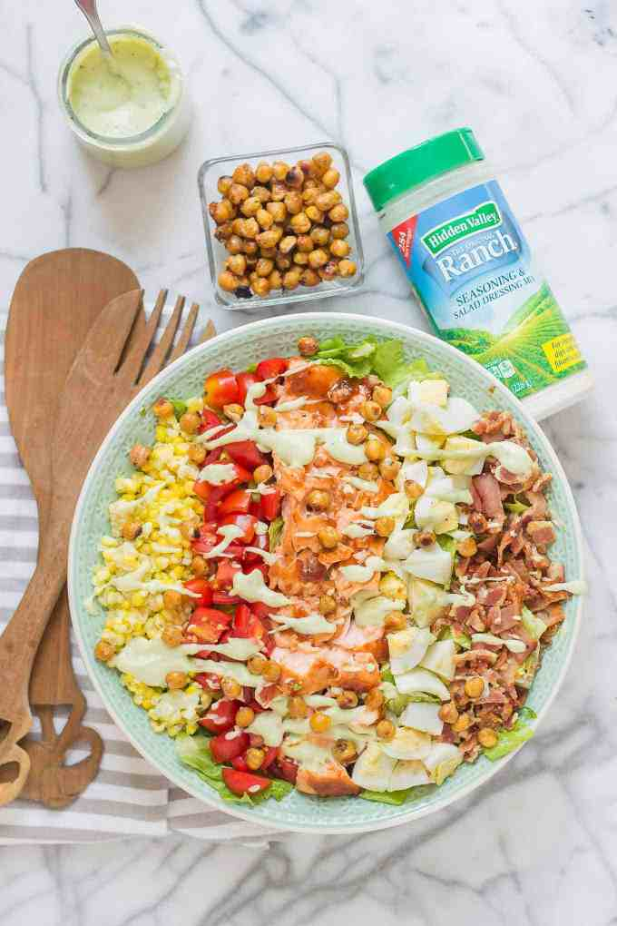 BBQ salmon cobb salad with Avocado Ranch Dressingis bursting with flavors to savor summer! Topped with a delicious crunch from ranch flavored chickpeas it's sure to be your next favorite salad! | Strawberry Blondie Kitchen