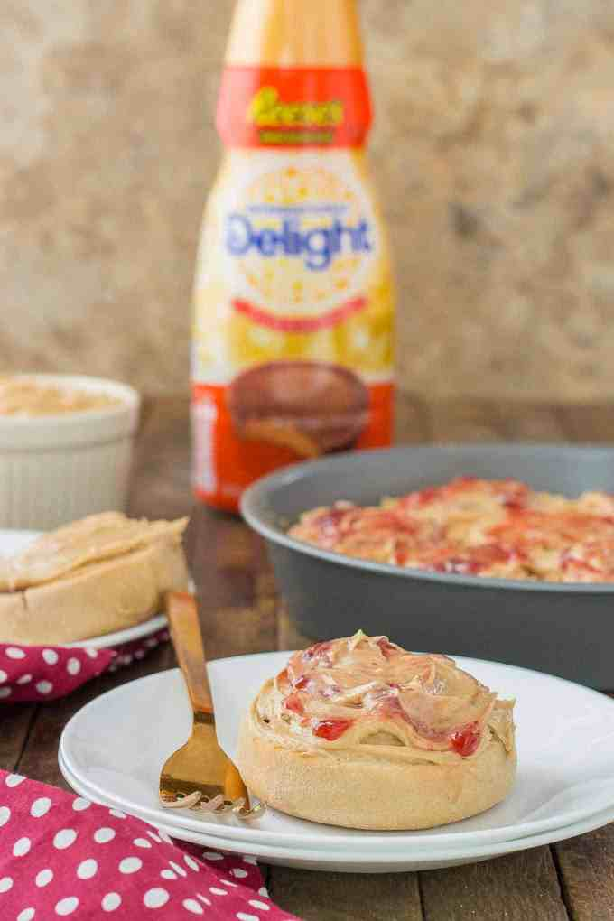 These Peanut Butter and Jelly Breakfast rolls are breakfast bliss. Peanut butter flavored rolls, stuffed with jelly and topped with a peanut butter frosting are the best breakfast rolls yet!   Strawberry Blondie Kitchen
