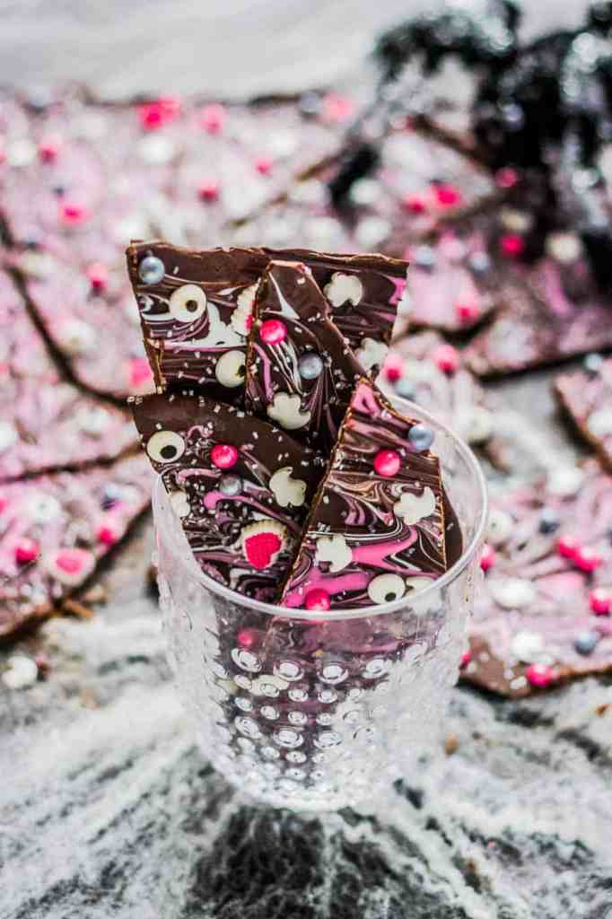 Super pretty and sparkly Halloween colors such as pink, silver and black make this Pink-O-Ween Candy Bark fun and creative.  Share it with the pink lover in your life! 💕 | Strawberry Blondie Kitchen
