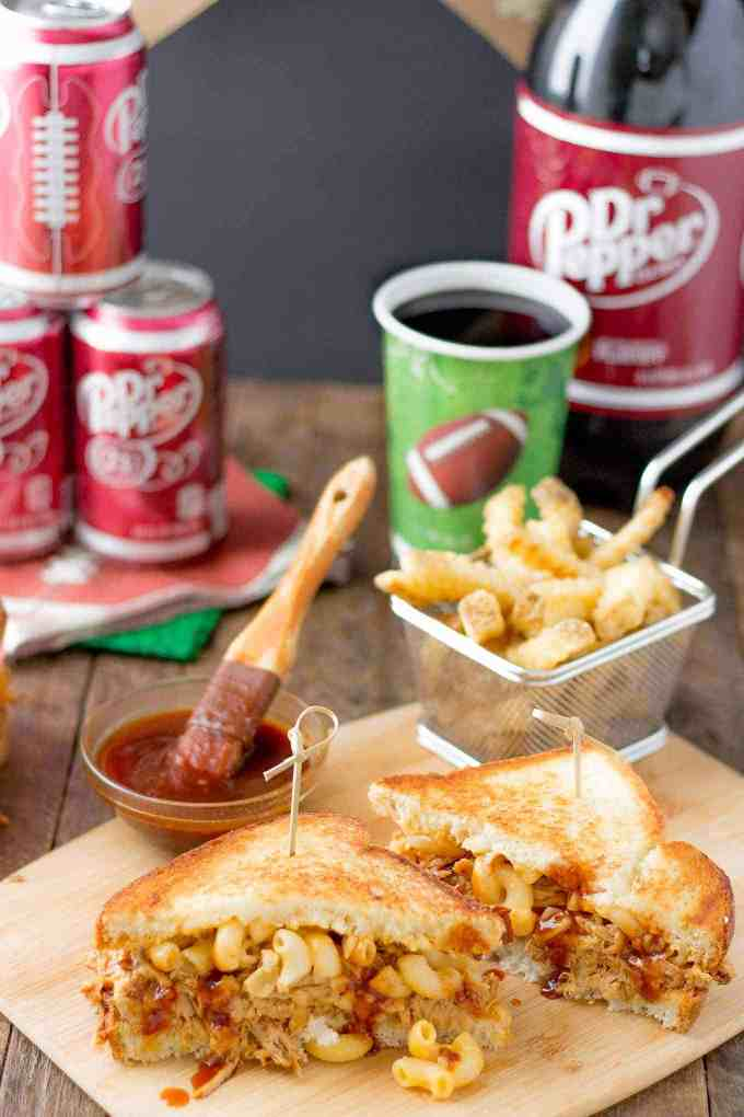 These Dr Pepper Pulled Pork n Mac Sandwiches are a combination of sweet, sharp and tangy. They're amazing for to feed a crowd on game day, just bring extra napkins. | Strawberry Blondie Kitchen