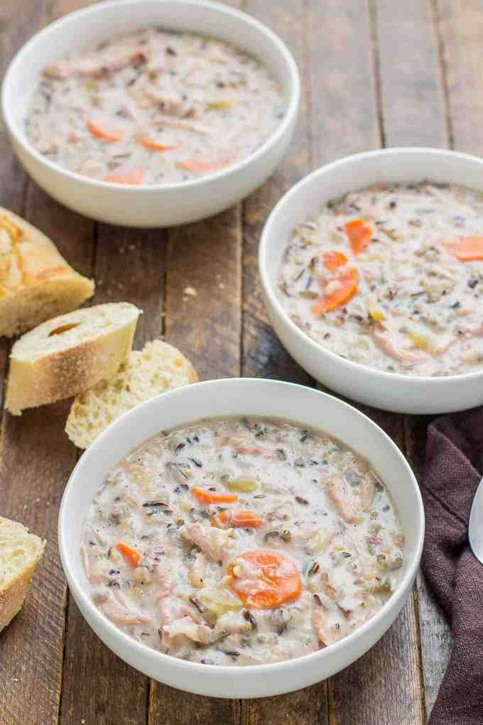 Creamy, delicious and pure comfort food, thishealthy Crockpot Chicken and Wild Rice Soup comes together quickly thanks to your slow cooker. Serve it tonight with some bread for dunking!| Strawberry Blondie Kitchen