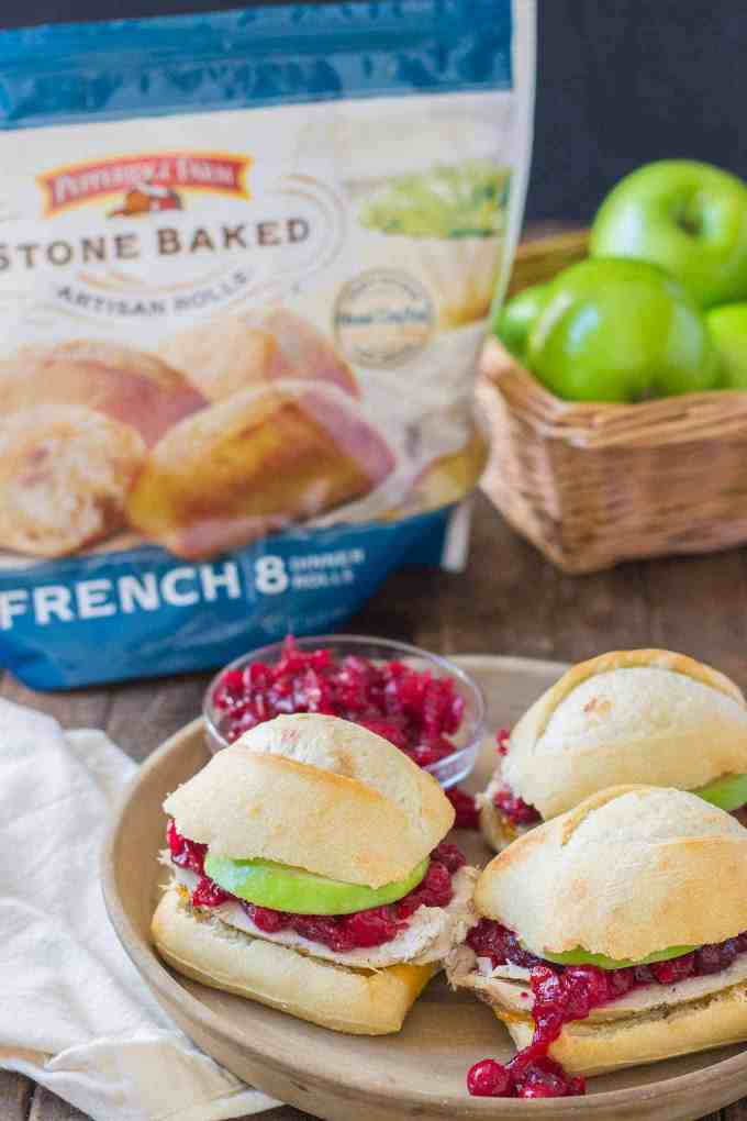 Crispy rolls, smoky turkey and cheese, with tart apples and sweet cranberry sauce come together harmoniously to create these Turkey Cheddar Cran Apple Sliders which are perfect for Thanksgiving leftovers. | Strawberry Blondie Kitchen