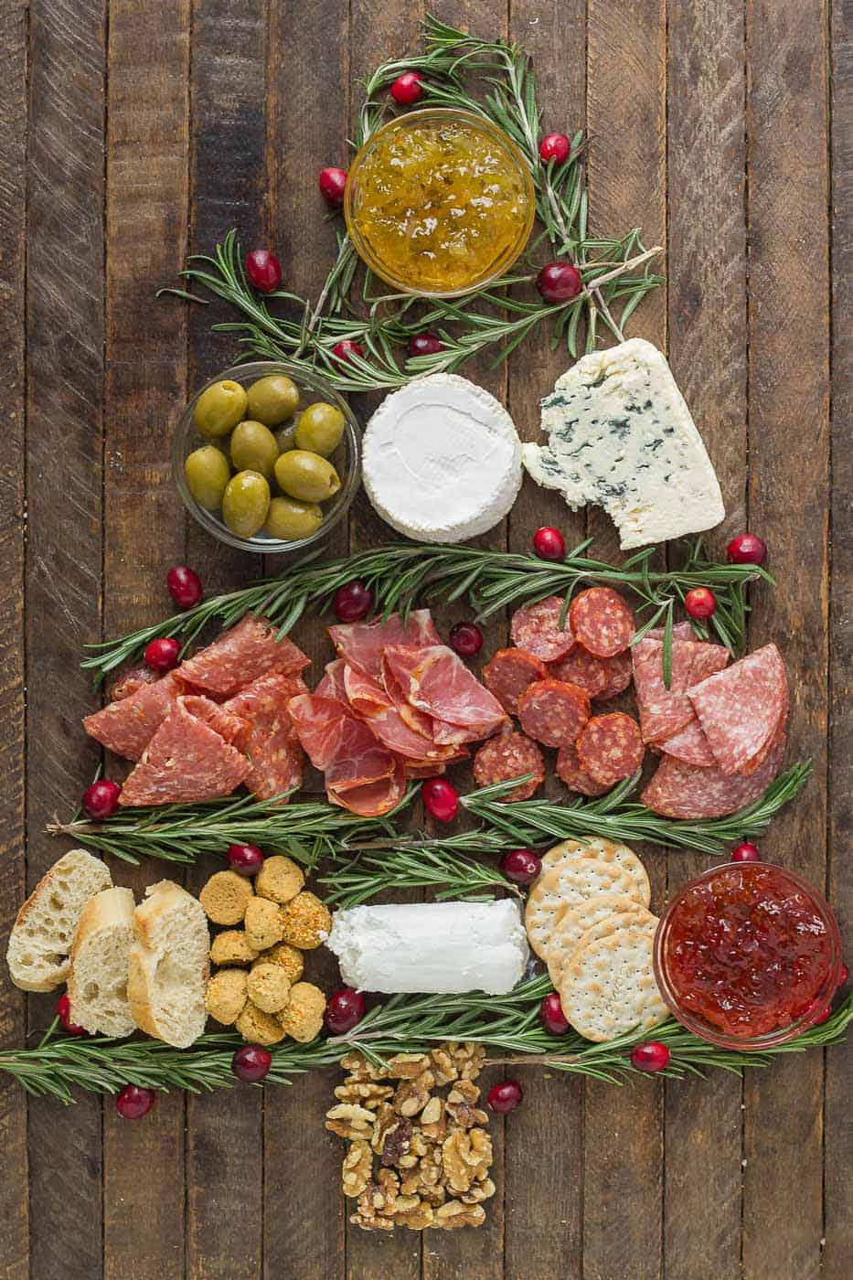 Impress your guests with this Christmas Tree Charcuterie filled with gourmet cheeses, meats and crackers.  The perfect way to start any holiday or cocktail party this season and don't forget the wine! | Strawberry Blondie Kitchen