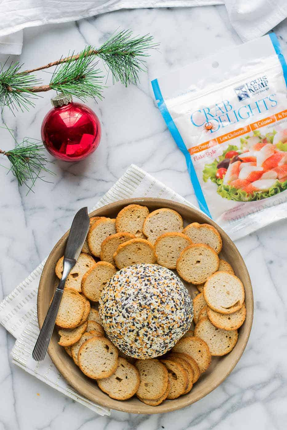 This Crab and Everything Bagel Cheese Ball is packed with crab, fresh herbs and rolled in everything bagel seasoning.  An appetizer worthy of your next get together! | Strawberry Blondie Kitchen