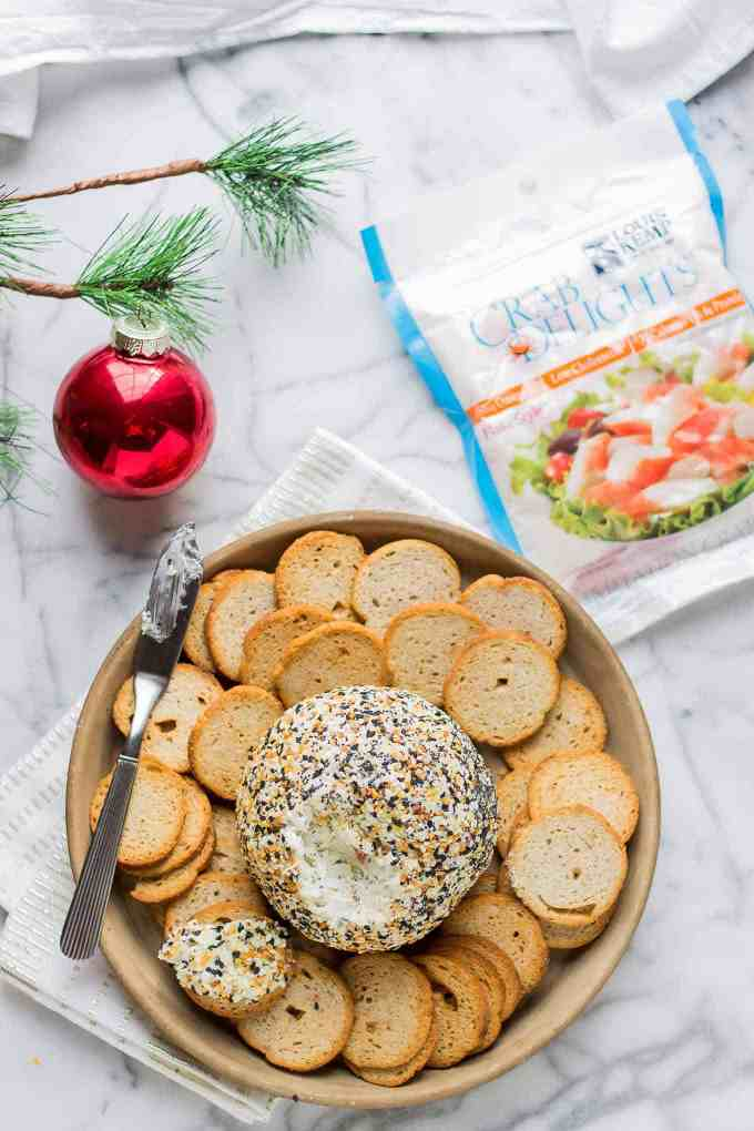 ThisCrab and Everything Bagel Cheese Ball is packed with crab, fresh herbs and rolled in everything bagel seasoning. An appetizer worthy of your next get together! | Strawberry Blondie Kitchen