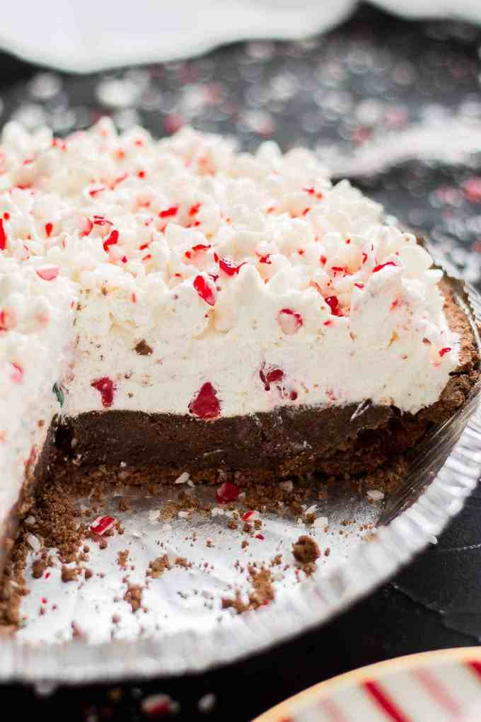 Layers of JELL-O chocolate pudding, creamy cream cheese filling and crushed peppermint candies make this No Bake Candy Cane Pie the perfect holiday dessert! | Strawberry Blondie Kitchen