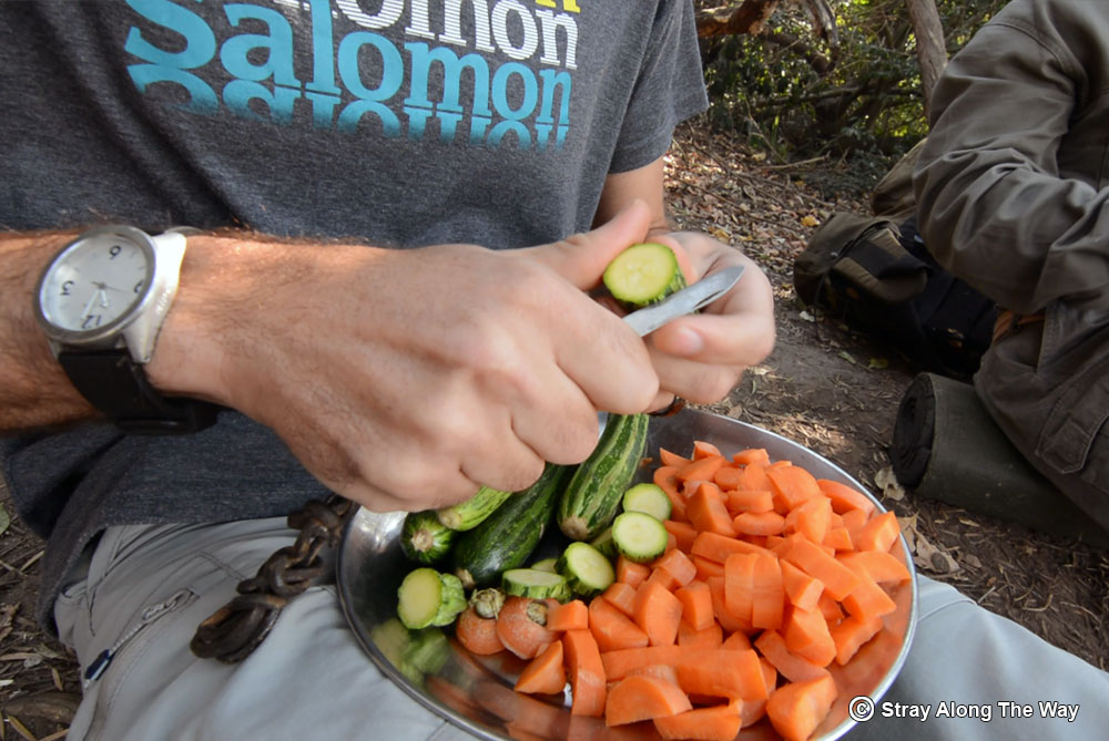 Cutting some vegetables for our trail dinner.