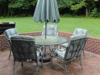 Metal round patio table with glass top and lazy Susan and ...