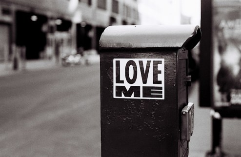 a love me sticker found on an emergency call box in NYC
