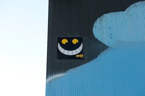 cheshire cat street art in NYC