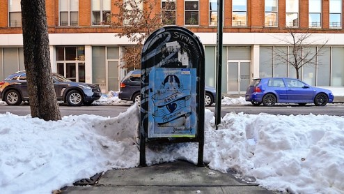 blue street art by ASVP in the snow in NYC