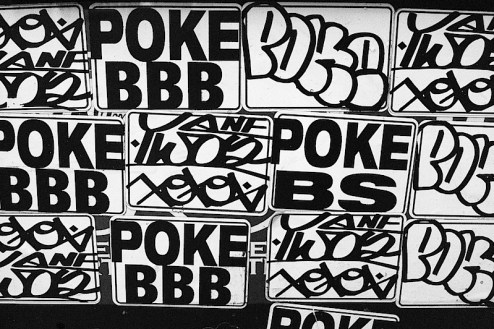 Poke graffiti stickers in SoHo, NYC