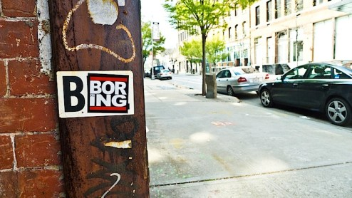 BNE covered up by a Boring sticker
