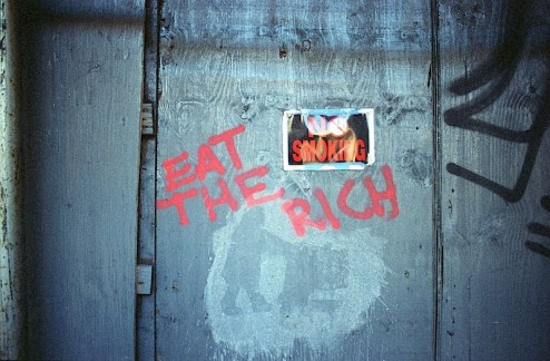 eat the rich graffiti in the lower east side of NYC