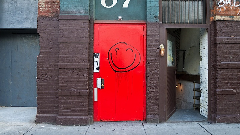 a_smiley_face_on_a_door_on_houston_st.jpg