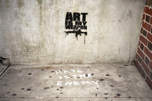 hate is the enemy and art is my weapon graffiti by TMNK / Nobody