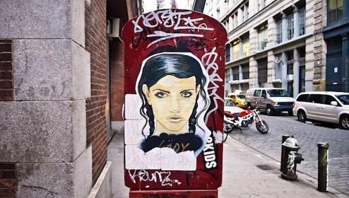 street art by lady in SoHo, NYC