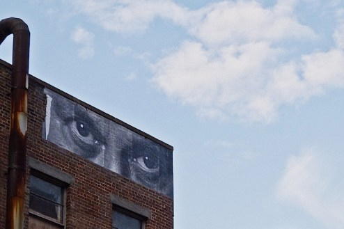 street art by JR found in NYC on the candy factory