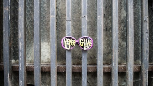 never give up sunglasses street art found in NYC