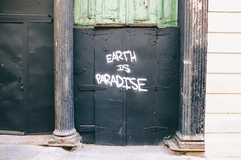 earth is paradise graffiti found in chinatown, nyc