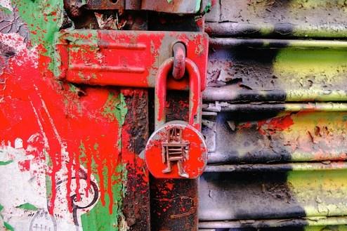 street artist stikman artwork on a lock in nyc