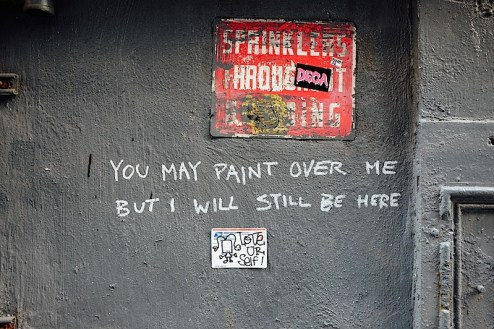 you may paint over me but i will still be here