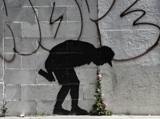 Street Art by Banksy - Better out than in