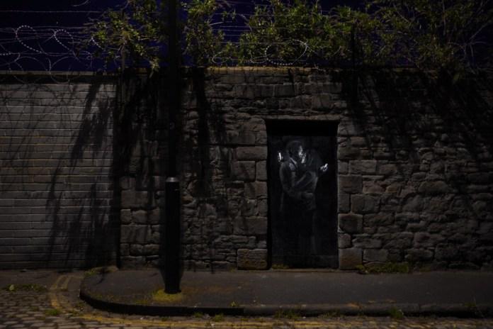 Phone Lovers - Street Art by Banksy in Bristol, England 2