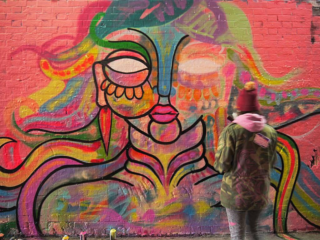 Amara Por Dios adds to the Leake Street Tunnel mural