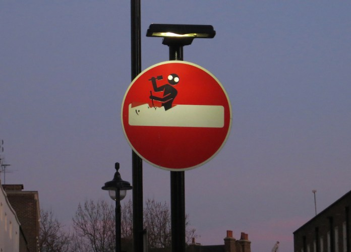 Street Art Sign by Clet Abraham in London, England