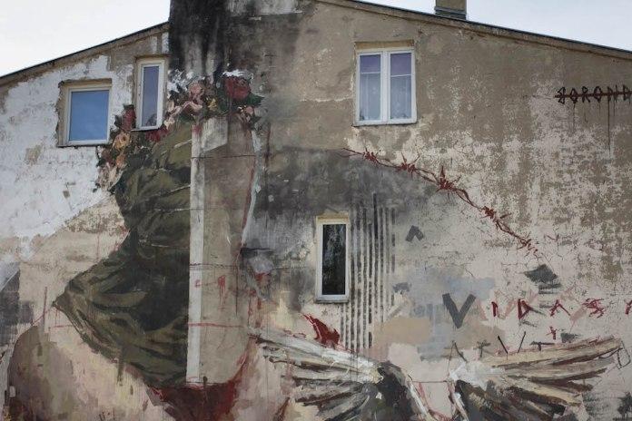 Mural by Borondo in Lodz, Poland 2