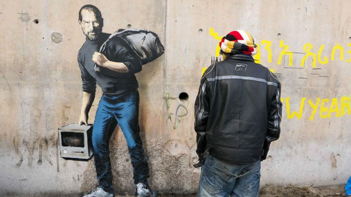 By Banksy – Steve Jobs, the son of a migrant from Syria