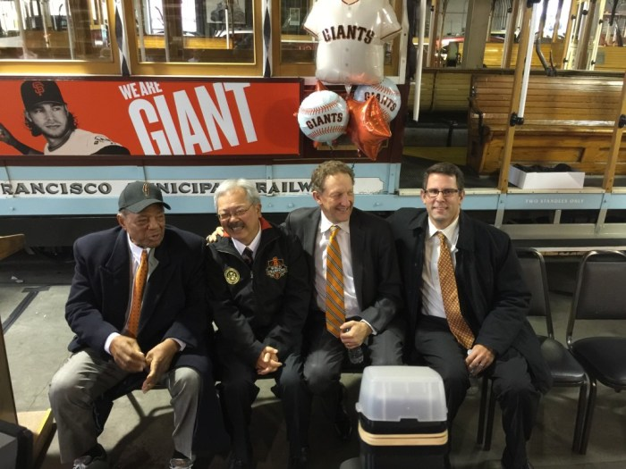 Left to right, Willie Mays, Mayor Ed Lee, Giants President and CEO Larry Baer, and SFMTA Board Member Malcolm Heinecke chat in front of Willie's cable car No. 24 before the dedication ceremony.