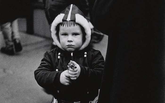 Child with toy gun by Diane Arbus