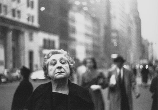 Lady with eyes closed in street by Diane Arbus