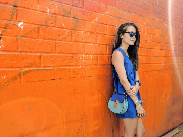 girl standing in front of orange wall