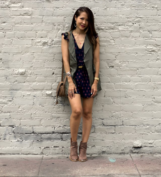 navy floral romper and army vest outfit