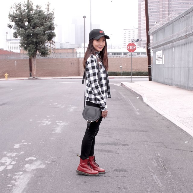 girl wearing red doc martens