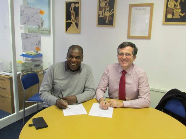 Eustace Constance and Peter Dunn signing the agreement