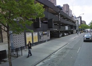 City Planning needs to decide whether to legalize this parking garage make its illegal extra cars