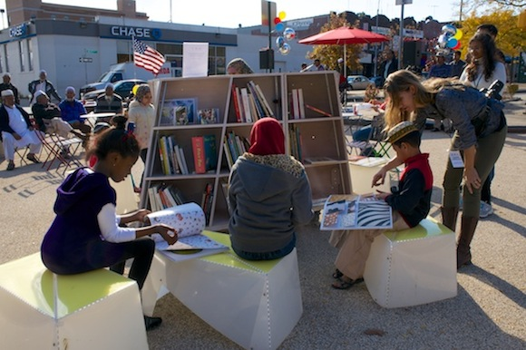 Ozone Park children read at The Uni portable library during the November 2 grand opening. Photo: DOT/The Unit