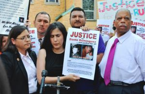 Family members of hit-and-run victim Dante Dominguez, with Council Members Rosie Mendez and Leroy Comrie. Photo: ##http://www.qchron.com/editions/queenswide/flushing-hit-and-run-inspires-council-bill/article_232113e3-a3d4-5ca0-97dd-f26b871953ca.html##Queens Chronicle##