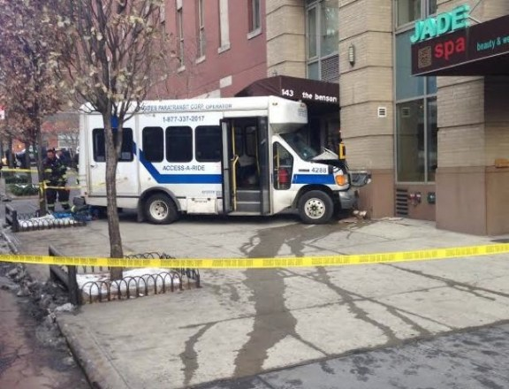 An Access-a-Ride Driver jumped the curb on 34th Street, injuring one pedestrian. Photo: ##http://gothamist.com/2013/12/19/two_injured_in_access-a-ride_crash.php##Gothamist##