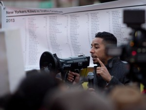 Council Member Antonio Reynoso speaks before a banner listing the names of New Yorkers killed in traffic violence since the start of last year. Photo: Anna Zivarts